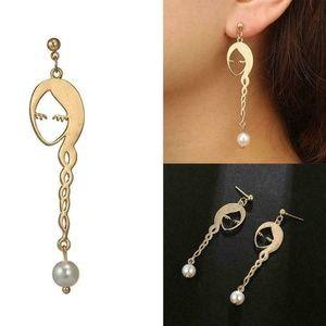 Jewelry - New Face Silhouette Dangle Gold Earrings